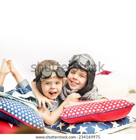Two boys in a pilot hats - stock photo