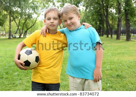 two boys in the park with a ball - stock photo