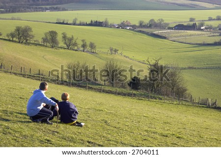 Two boys looking at the view across a valley