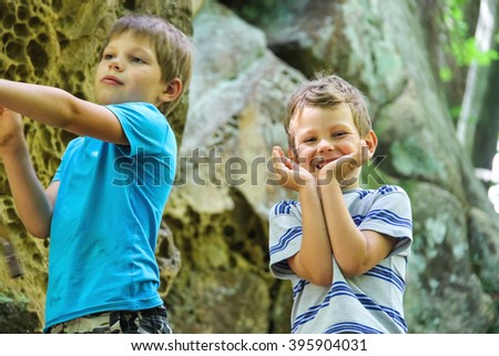 Two boys on a walk in the park. - stock photo