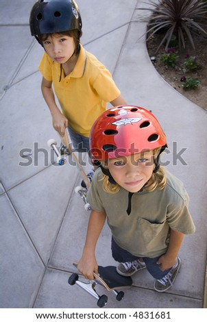 Two boys on Skateboards - stock photo
