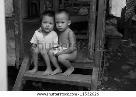 Two boys on steps in Philippines - stock photo