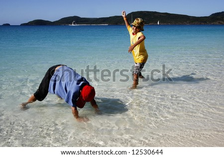 Two Boys Playing at the Beach - stock photo