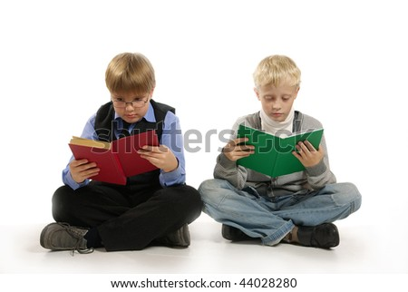 Two boys set with book and read them.