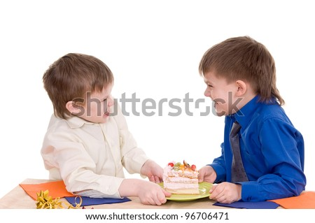Two boys share a piece of cake on white background - stock photo