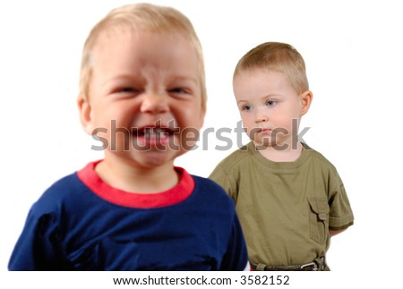Two boys show different expressions. Isolated over white background
