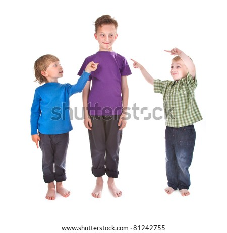 two boys showing who is guilty - stock photo