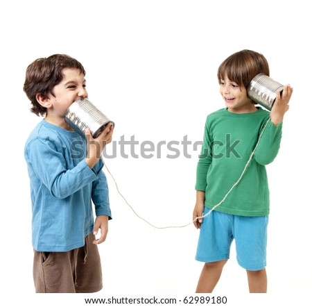 Two boys talking on a tin can phone isolated on white