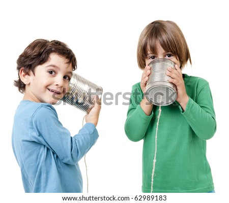 Two boys talking on a tin can phone isolated on white - stock photo