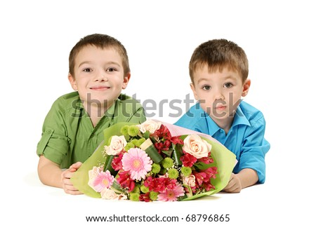 Two boys with bouquet of miscellaneous flowers isolated on white background - stock photo