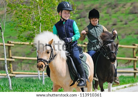 Two boys with pony - stock photo