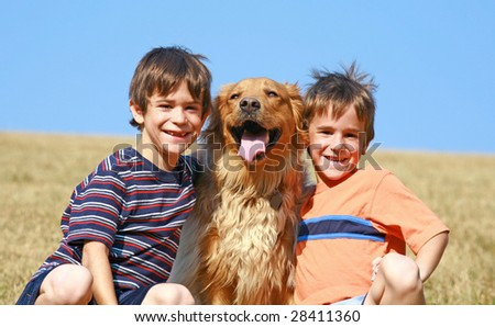 Two Boys with Their Dog - stock photo