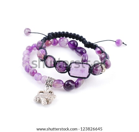 Two bracelets with amethyst on white background - stock photo