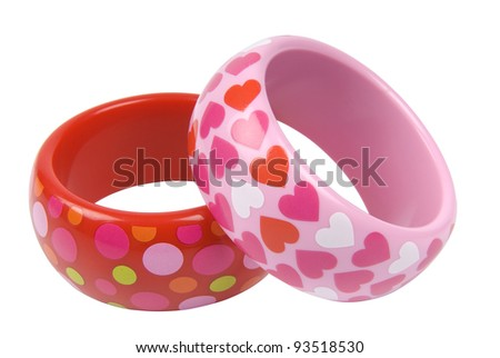 Two bracelets with patterns on white background, clipping path included - stock photo