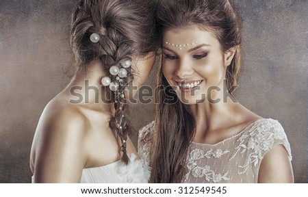 Two brides all dressed up - stock photo