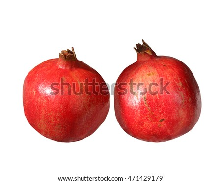 two bright and ripe pomegranates isolated on white