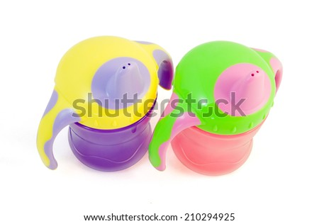 Two bright colored sip cups isolated on a white background. Clipping path included. - stock photo