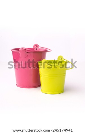 Two bright colourful buckets on the white isolated background - stock photo