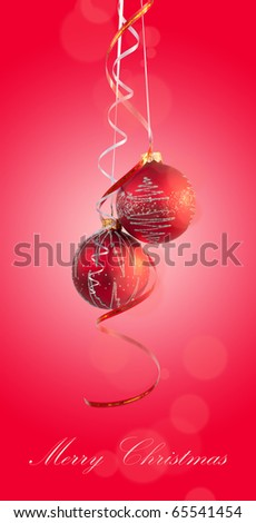 Two bright red Christmas ball with curly ribbons on red background - stock photo