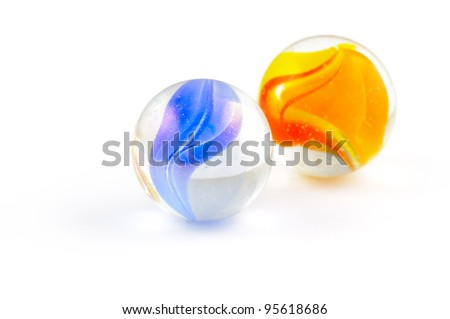 Two brightly colored glass marbles isolated on white - stock photo
