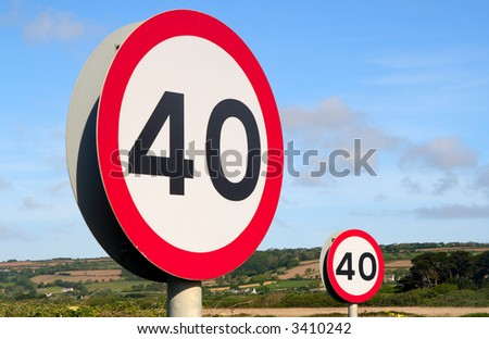 Two British 40 miles per hour signs. - stock photo