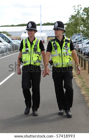 Two British Police Constables on patrol and in uniform - stock photo