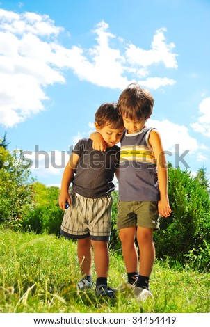 Two brother hugging each other outdoor - stock photo