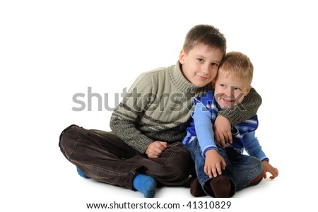 Two brothers. Age of 3 and 7 years. It is isolated on a white background