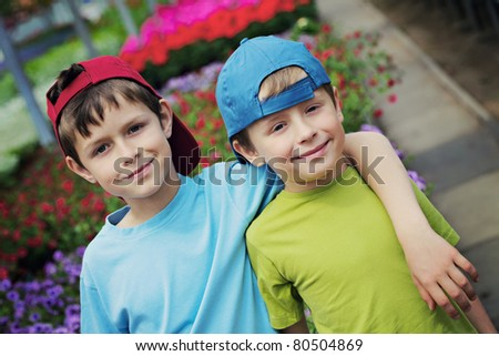 two brothers as a gardeners - kids and family - stock photo