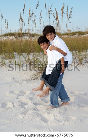 Two brothers at the beach. - stock photo