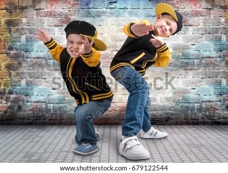 Two Brothers Dancing Break Dancehiphop Style Stock Photo