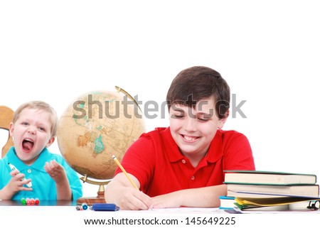 Two brothers doing homework - stock photo
