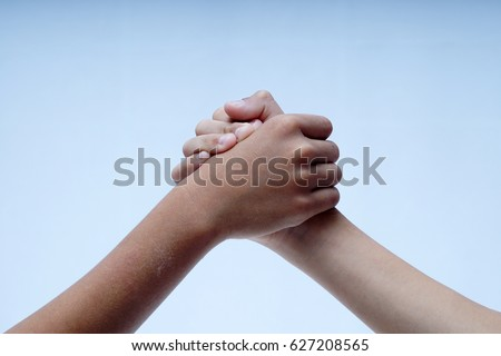 Two brothers holding hands as a symbol of unity, brotherhood and solidarity.