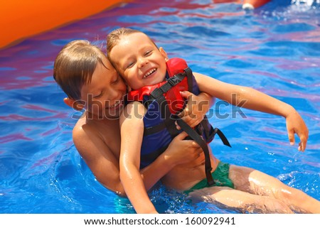 Two brothers in swimming pool at the water park