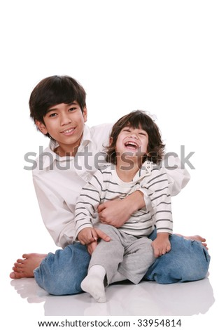 Two brothers laughing together, both are of part Asian - Scandinavian descent - stock photo