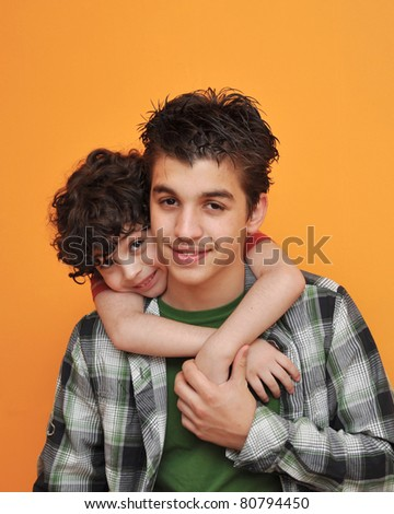 Two brothers play together and enjoy each other's company - stock photo