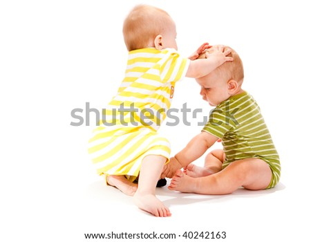 Two brothers playing, isolated, over white - stock photo