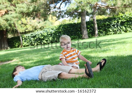 Two brothers playing outside in the park - stock photo