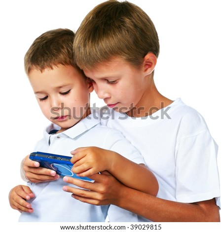 two brothers playing portable video game - stock photo