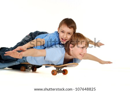 Two brothers riding on a skateboard on a white background