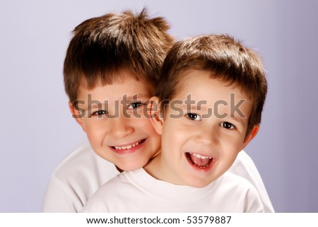 two brothers smiling - stock photo