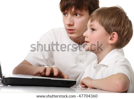 Two brothers with laptop - stock photo