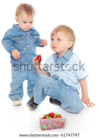 Two brothers with strawberry. Isolated on white background - stock photo