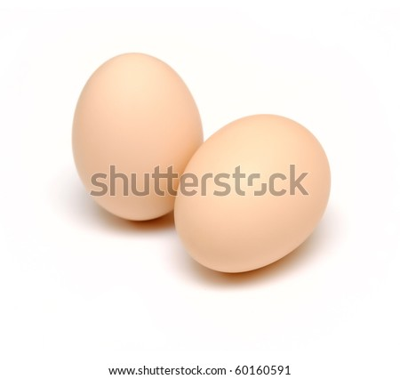 two brown eggs isolated on white - stock photo