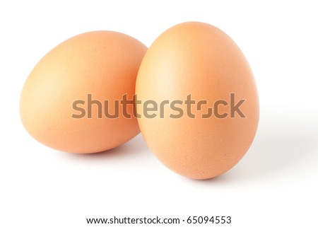 Two brown eggs isolated on white background - stock photo