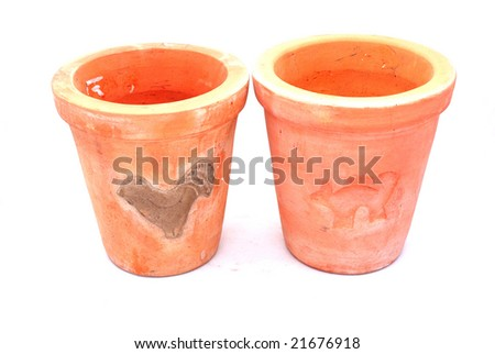 Two brown flower terracotta pots isolated on white background - stock photo