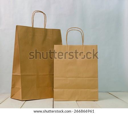 two brown kraft bag on wood white desk - stock photo