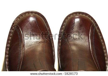 Two brown leather shoes isolated on white background