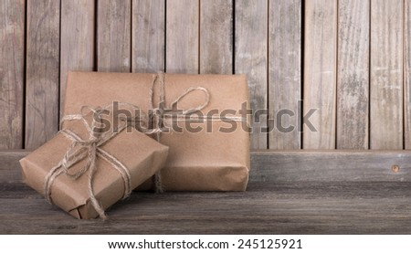 Two brown packages on a wood background - stock photo