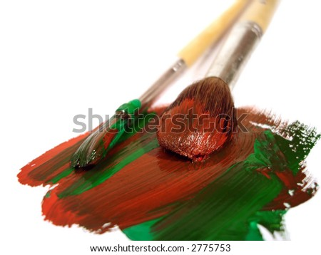 two brushes with red and green paints - stock photo